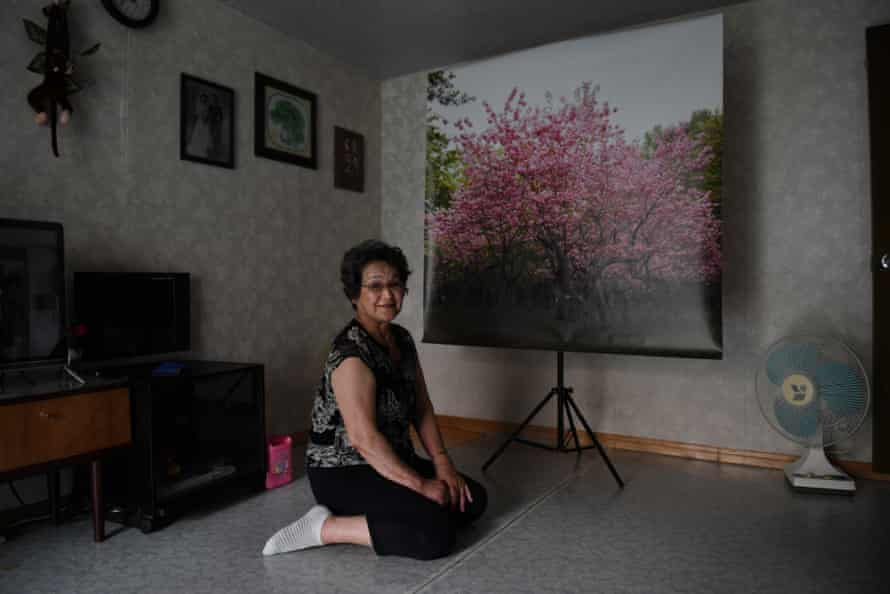 Mitsuko Minakawa looks at a photograph of the cherry blossoms in Maruyama park which she lived near and often visited as a child. She moved to North Korea in April 1960 with her Korean husband and has been living there ever since.