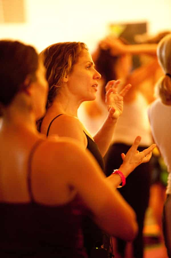 Yoga teacher Seane Corn speaking during her yoga class.