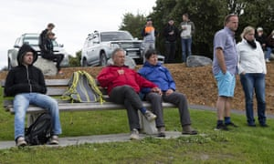 Stranded tourists gather at a park in Kaikoura following an earthquake in New Zealand, Monday.