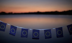 EU flags in front of a beautiful nascent dawn