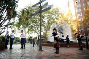 Khiara Aoun and her brother Khoda Aoun perform Amazing Grace on their bagpipes as police speak to their father near the El-Alamein fountain on Macleay Street, Kings Cross, Sydney.