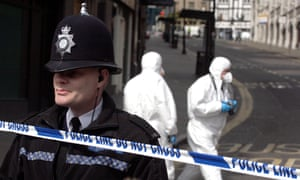 Police and a forensics team investigate a stabbing in Nottingham city centre.