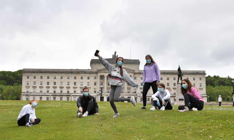 A group of friends meet up for the first time since the Covid-19 lockdown began, at Stormont on 19 May.