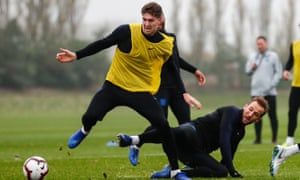 Harry Kane, right, challenges John Stones during England training; both players are likely to return for the Nations League decider against Croatia.