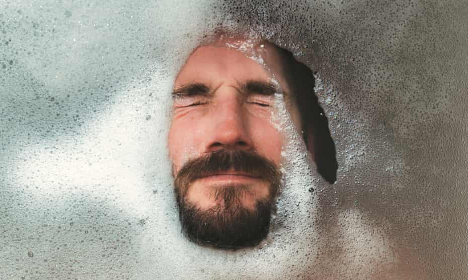 Close-Up Of Bearded Man Relaxing In BathtubPosed by model GettyImages-1300122538