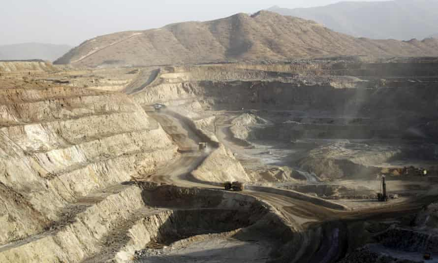Trucks ferry excavated gold, copper and zinc ore from the main mining pit at the Bisha Mining Share Company in Eritrea.