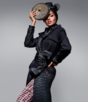 Fashion meets activism: Halima Aden wears coat by Gabriela Hearst, selfridges.com; top by charlotteknowles.com; belt by varanaworld.com; and bag by bottletop.com.