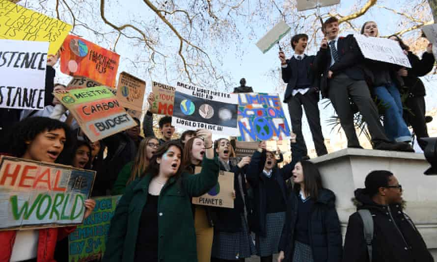 Students take part in the climate change strike in London.