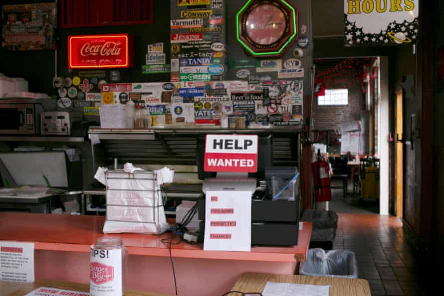A help wanted sign is seen at the register of Burger Boy restaurant in Louisville, Kentucky.