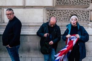 Woman wearing Theresa May mask