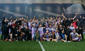 Exeter players and staff celebrate winning the Champions Cup against Racing 92