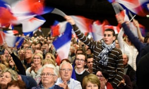 Fillon's supporters wave flags at the Lyon rally.