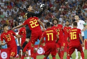 Belgium goalkeeper Thibaut Courtois plucks the ball from the air.