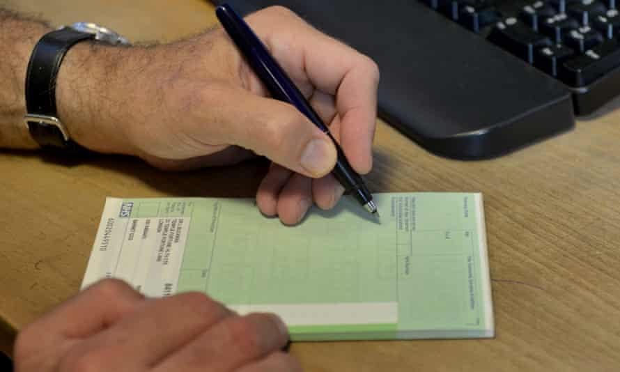 GP writing out a prescription