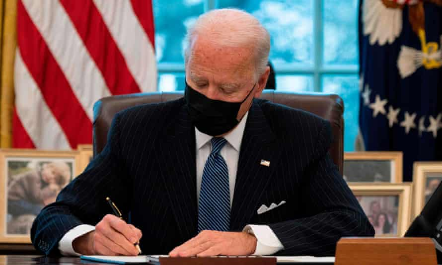 Joe Biden signs an executive order reversing Trump's ban on transgender people serving in the military.