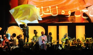 Before the war … the Syrian National Orchestra for Arabic Music on stage with Damon Albarn and Gorillaz in London in 2010.