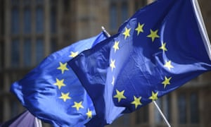 Activists wave European Union flags outside the Houses of Parliament in Westminster, London.