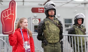 A volunteer stands with a security guard in St Petersburg