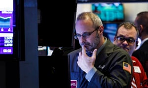 Traders at the New York Stock Exchange keep an eye on the effects of the federal government shutdown.