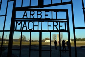 Visitors behind a gate at the Sachsenhausen concentration camp memorial in Oranienburg, Germany