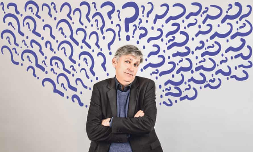 steven johnson poses arms crossed his head and upper torso surrounded by question marks