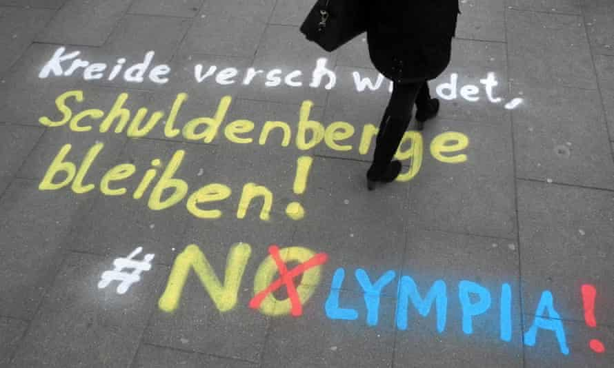 'Chalk disappears, mountains of debt remain! NOlympia!': an anti-Olympics message at the exit of a subway station in Hamburg, Germany