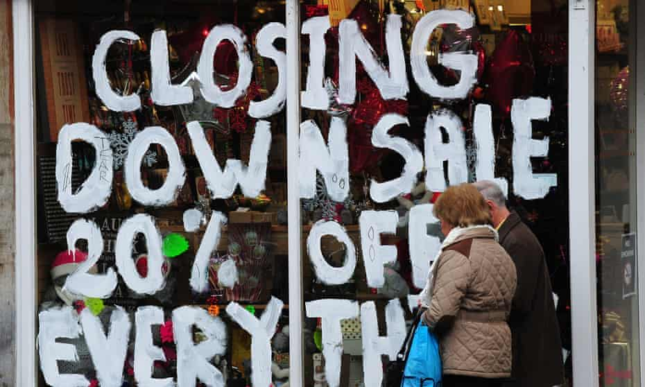 A shop window with a closing-down sign