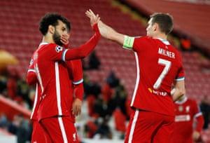 Salah celebrates scoring from the penalty spot