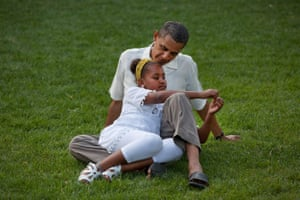 Obama sits with daughter Sasha during celebrations for his 49th birthday