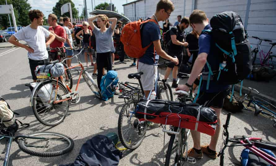 Cyclists from the Critical Mass group make final adjustments to their bikes as they prepare to ride from south-east London to Calais to donate bicycles and supplies to people in the migrant camps.