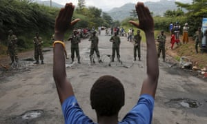 A man stands in front of soldiers outside Burundi's capital during a protest against president Pierre Nkurunziza.