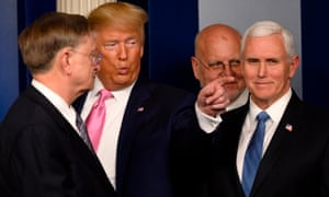 US President Donald Trump (2nd L) flanked by US Vice President Mike Pence (R), after speaking at a news conference on the COVID-19 outbreak at the White House on February 26.