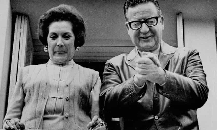 Salvador Allende and his wife, Hortensia Bussi de Allende, smile at reporters from the window of their home in Santiago, 5 September 1970.