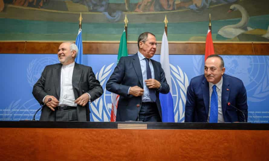 The foreign ministers of Iran, Russia and Turkey at a press conference on a meeting of the Syria committee in Geneva.