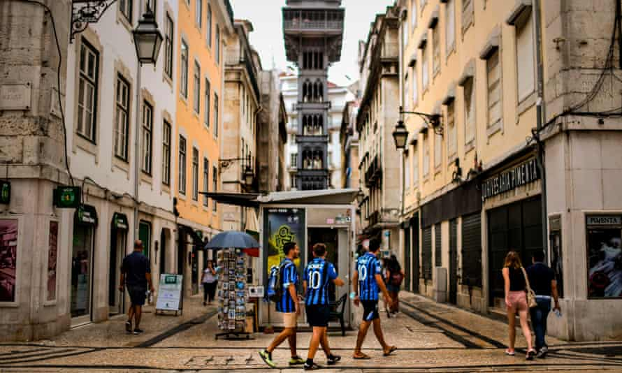 Three Atalanta fans in downtown Lisbon. Their team face PSG in the Portuguese capital tonight.