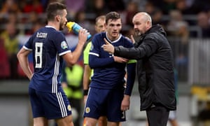 Steve Clarke instructs John McGinn and Andrew Robertson during Scotland's Euro 2020 qualifier in Russia.