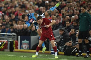 Napoli's Giovanni Di Lorenzo clashes with Liverpool's James Milner.
