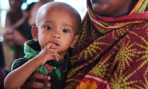 Rohingya refugees wait to be seen by a doctor at a camp in Bangladesh's Ukhia district