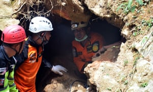 One of the holes rescue workers have used to bring out victims and survivors of the Indonesia mine collapse.