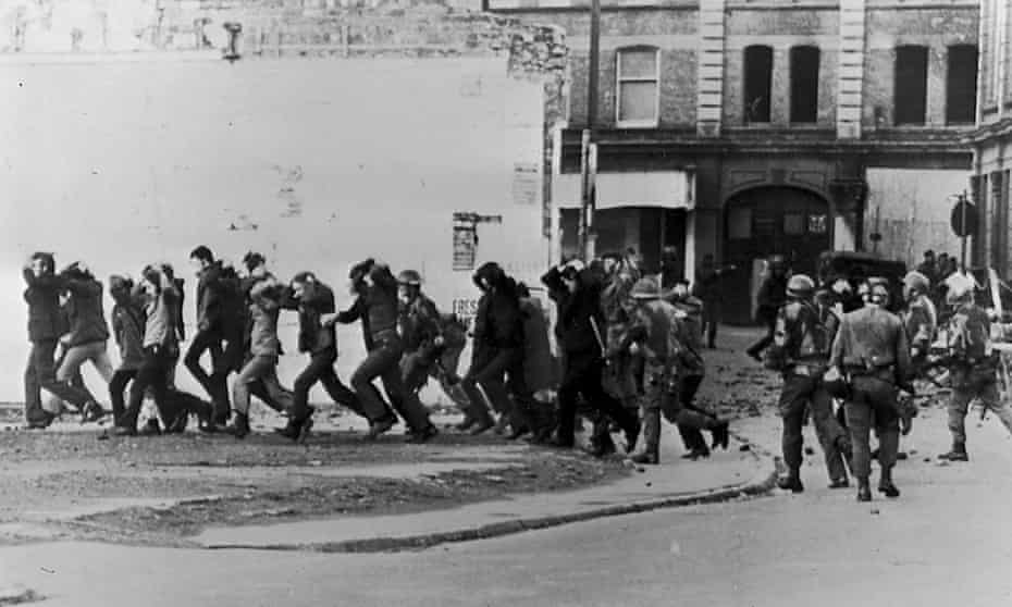 British paratroopers take away civil rights demonstrators after the paratroopers opened fire on a civil rights march in Derry, killing 14 civilians, 30 January 1972