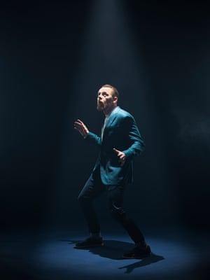 Simon Pegg under a spotlight