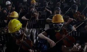 A clip from the YouTube video, showing the orchestra performing the tune in full protest battledress.