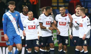 Darren Pratley, third from right, celebrates with team-mates after scoring Bolton Wanderers' third goal of the game.