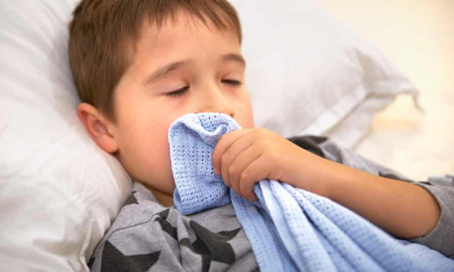 A young boy with his security blanket