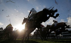 Runners in the Close Brothers Novices Handicap Steeplechase jump the first fence in the home straight during day one of the Cheltenham Festival