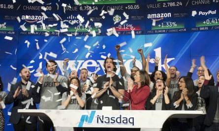 Adam Neumann, center, is leaving WeWork with a $1.7bn windfall.