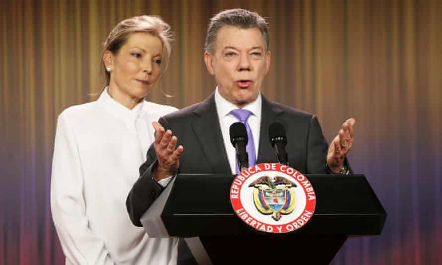 Juan Manuel Santos speaks to the press with his wife, Maria Clemencia Rodriguez, after winning the Nobel peace prize.