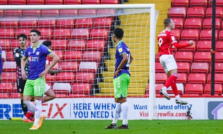 Cauley Woodrow is elated but Barnsley's added-time equaliser leaves Bristol City players disconsolate