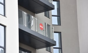 Sold signs adorn some windows and balconies at Alexandra Wharf, Southampton's Ocean Village