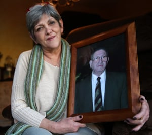 Hanna Zaidel, now in her sixties, holds a picture of her late father Motke Zaidel.